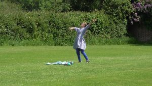 Carran as Terry's daughter dancing in a football field